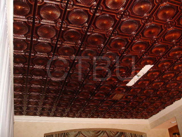 PVC ceiling tile in antique copper installed on smooth surface
