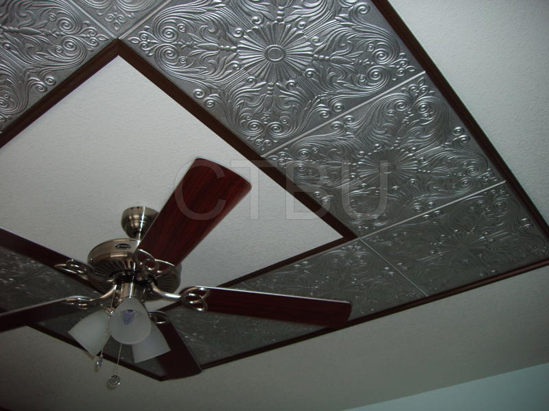 silver-tiles-around-ceiling-fan