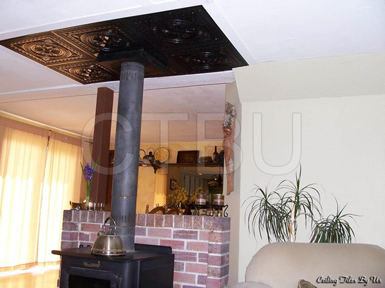 Decorative styrofoam ceiling tiles placed over popcorn ceiling, no removal needed.