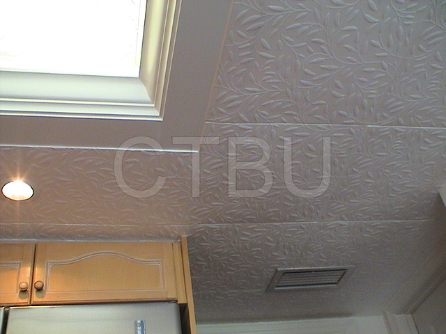 Covers popcorn ceiling. Kitchen renovation with Styrofoam ceiling tiles.