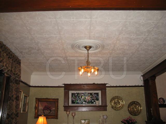 DIY house repairs renovating living room ceilings.