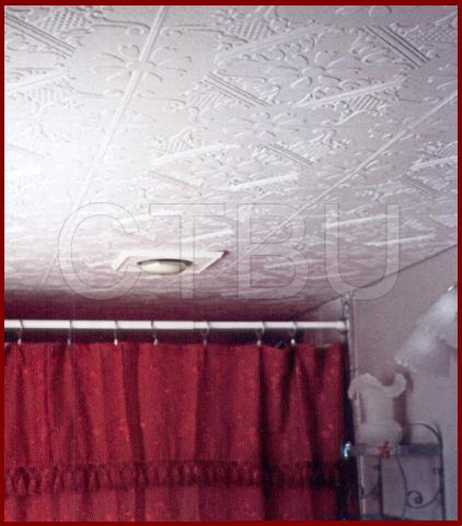 How to remove a popcorn ceiling in a bathroom? Use Styrofoam decorative ceiling tiles. They are easy to apply and very cost efficient
