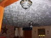 Remove the cost of asbestos ceilings, by gluing Styrofoam ceiling tiles over existing surface.