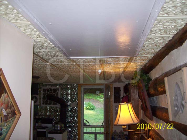 white-ceiling-tile-log-cabin-installed-1